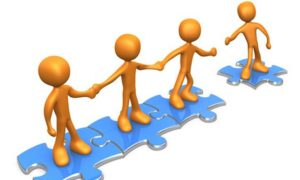 cartoon peple on puzzle pieces linking hands with each other and inviting a fourth person to join